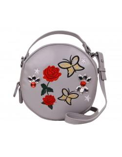 Mała okrągła haftowana torebka typu kuferek
